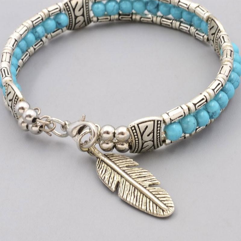 bracelet argent turquoise avec plume en m tal pas cher. Black Bedroom Furniture Sets. Home Design Ideas
